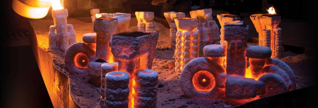 pouring molten metal in lost wax casting method