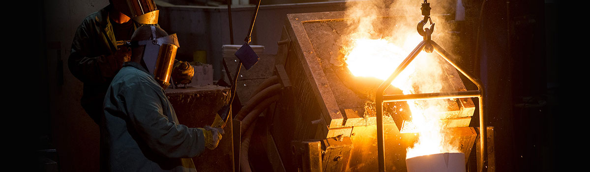 investment casting molten metal in the pour room